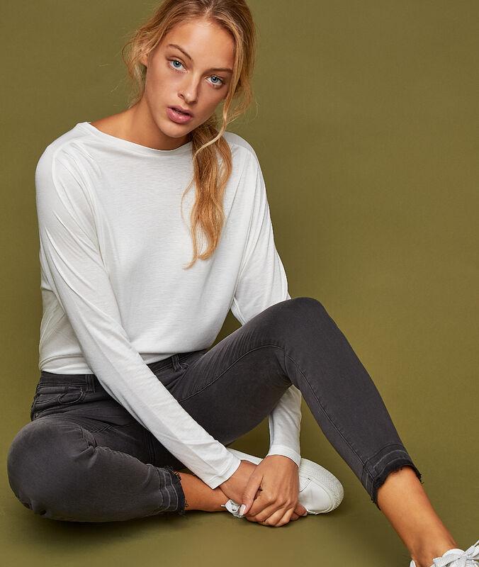 Pantalon 7/8 zippé noir.