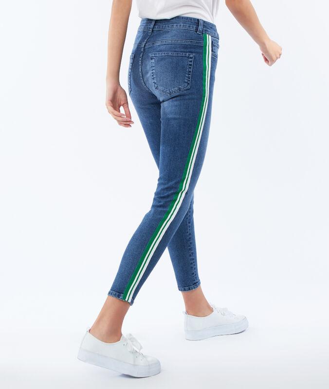Schmale jeans mit bordüre an der seite mittelblau verwaschen.